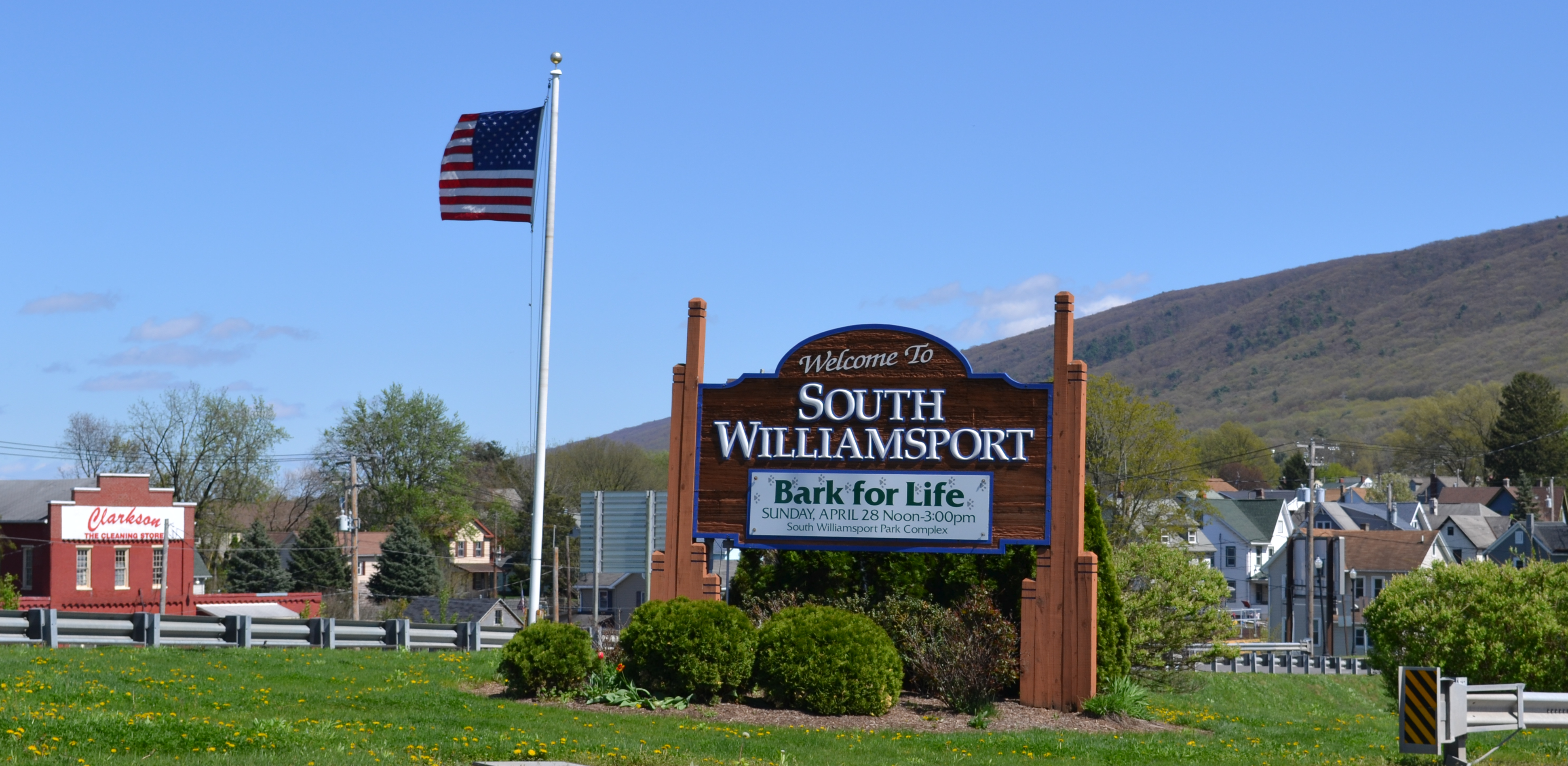 Welcome to South Williamsport sign with American flag